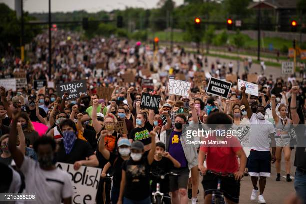 Protesters march on Hiawatha Avenue while decrying the killing of George Floyd on May 26 2020 in Minneapolis Minnesota Four Minneapolis police...