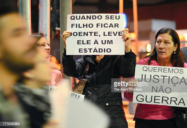 Protesters march on in the streets against transport fare rise and cost of staging World Cup on June 17 2013 in Sao Paulo Brazil