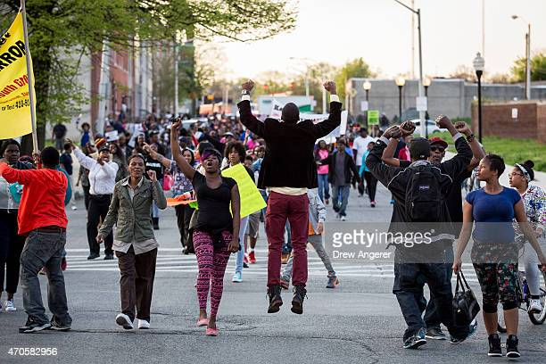 Protesters march on Laurens Street during a demonstration over the death of Freddie Gray April 21 2015 in Baltimore Maryland Gray died from spinal...