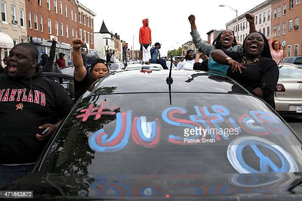 Protesters march on North Avenue after Baltimore authorities released a report on the death of Freddie Gray on May 1, 2015 in Baltimore, Maryland....