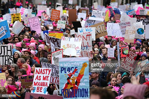 Protesters march on Pennsylvania Avenue during the Women's March on Washington on January 21 2017 in Washington DC
