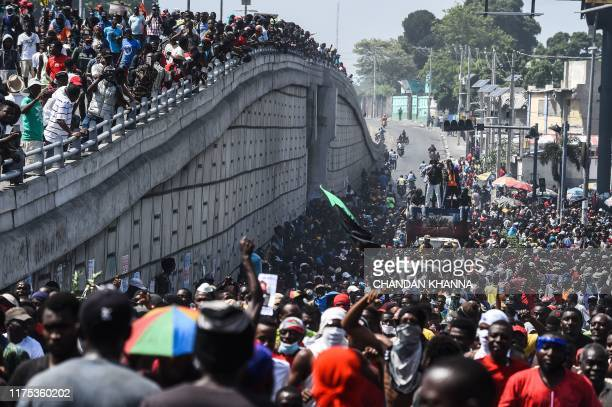 Protesters march on the street to demand the resignation of President Jovenel Moise in Port-au-Prince, Haiti on October 11, 2019. - thousand people...