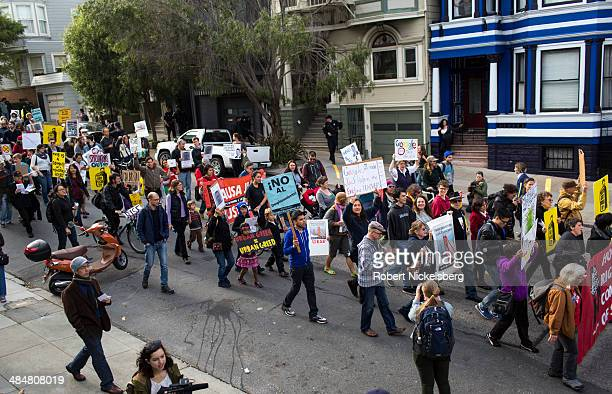Protesters march onto the house of Jack Halprin, a Google lawyer, April 11, 2014 after he purchased a multi-family house and illegally evicted six...