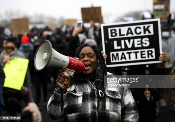 Protesters march outside the Brooklyn Center police headquarters on April 13, 2021 in Brooklyn Center, Minnesota. Demonstrations have become a daily...