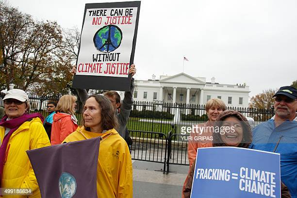 Protesters march outside the White House in Washington DC during a climate change rally on November 29 2015 Hundreds of thousands of people rallied...