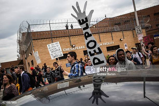 Protesters march past Chesapeake Detention Center in support of Maryland state attorney Marilyn Mosby's announcement that charges would be filed...