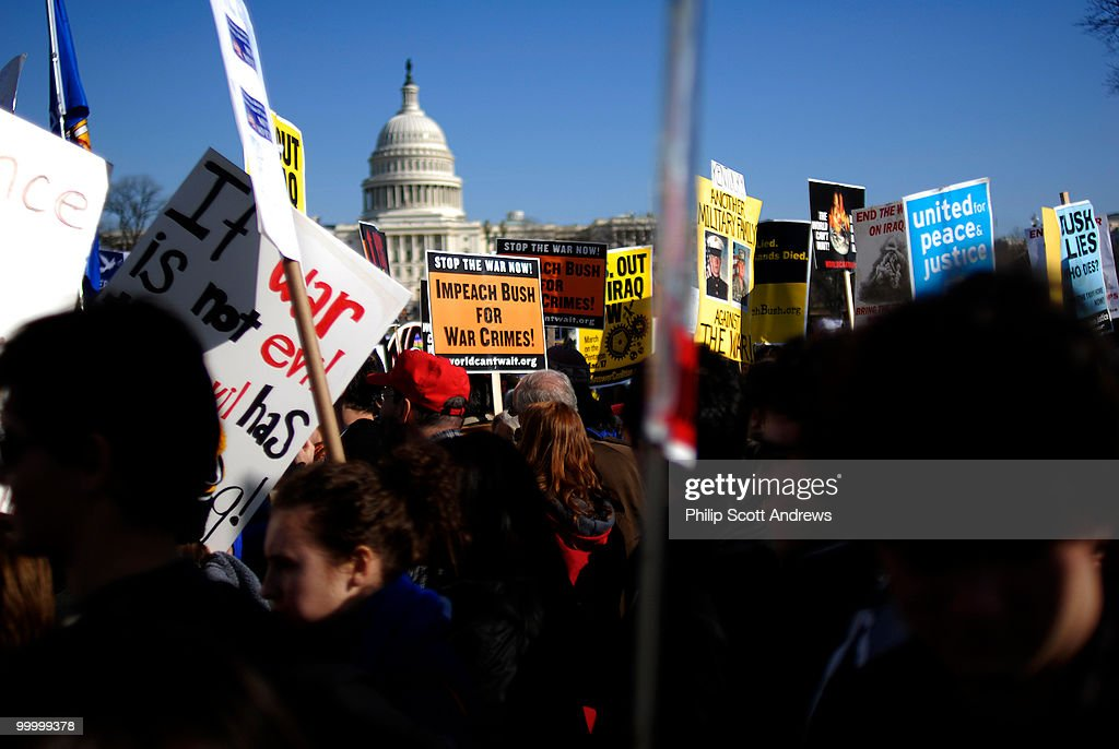 Protesters march past the U.S. Capitol, showing their opposition to the increasing war in Iraq.
