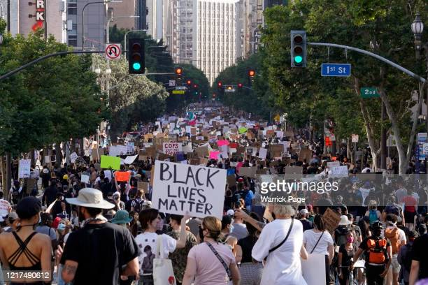 Protesters march through downtown during a peaceful demonstration over George Floyds death on June 3 2020 in Los Angeles California California...