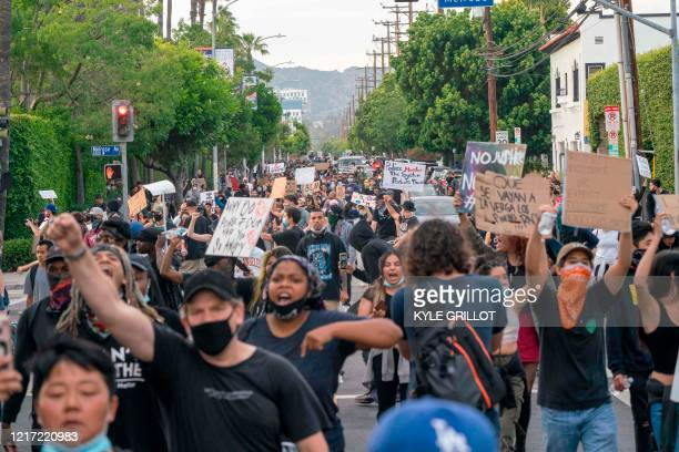 Protesters march through Hollywood after curfew during a demonstration over the death of George Floyd while in Minneapolis Police custody in Los...