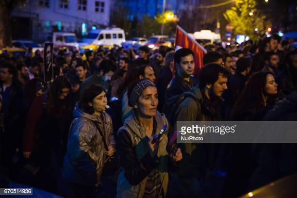 Protesters march through the Besiktas neighborhood of Istanbul on April 19, 2017. People marched in opposition to perceived voting irregularities in...