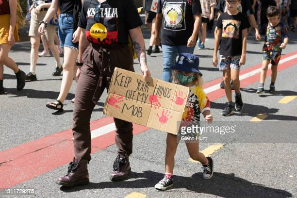 Protesters march through the Brisbane CBD during a rally on April 10, 2021 in Brisbane, Australia. The national day of action marks 30 years since...