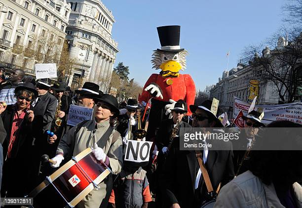 Protesters march through the capital during a march by thousands of demonstrators against the government's new labour reform law on February 19 2012...
