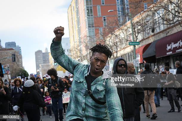 Protesters march through the streets during a 'Millions March' demonstration protesting the killing of unarmed black men by police on December 13...