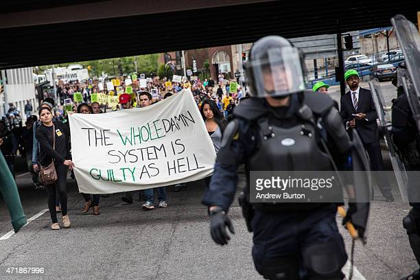 Protesters march through the streets in support of Maryland state attorney Marilyn Mosby's announcement that charges would be filed against Baltimore...