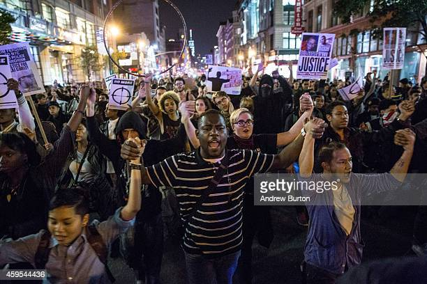 Protesters march through the streets of New York after learning at police officer Darren Wilson, of the Ferguson, MO police department, who fatally...