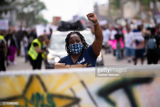 Protesters march through the streets while demonstrating against the death of George Floyd on May 26, 2020 in Minneapolis, Minnesota. Four...
