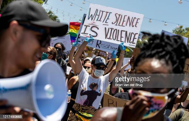 Protesters march through West Hollywood to demand justice for the killing of George Floyd during march on Wednesday June 3 2020 in West Hollywood CA