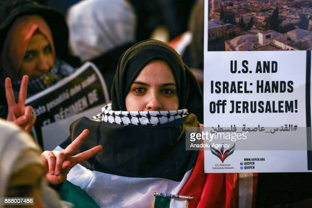Protesters march to Israeli Consulate General as they carry placards during a demonstration against the US President Donald Trumps recognition of...