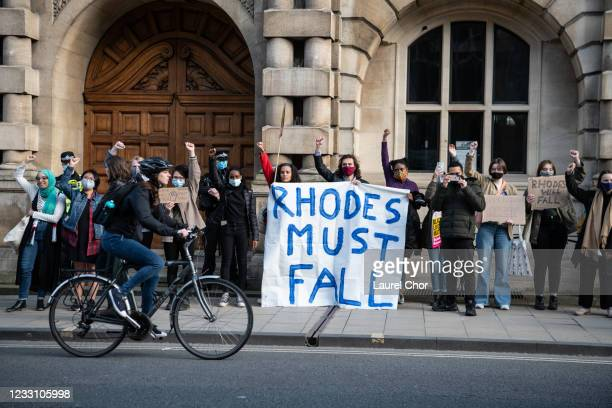Protesters march to Oriel Colleges statue of Cecil Rhodes at the University of Oxford on May 25, 2021 in Oxford, England. Today marked the first...