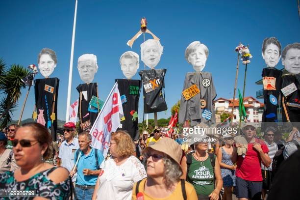 Protesters march to protest against the annual G7 Summit, 30 kilometres south of the G7 gathering in Biarritz, on August 24, 2019 in Hendaye, France....