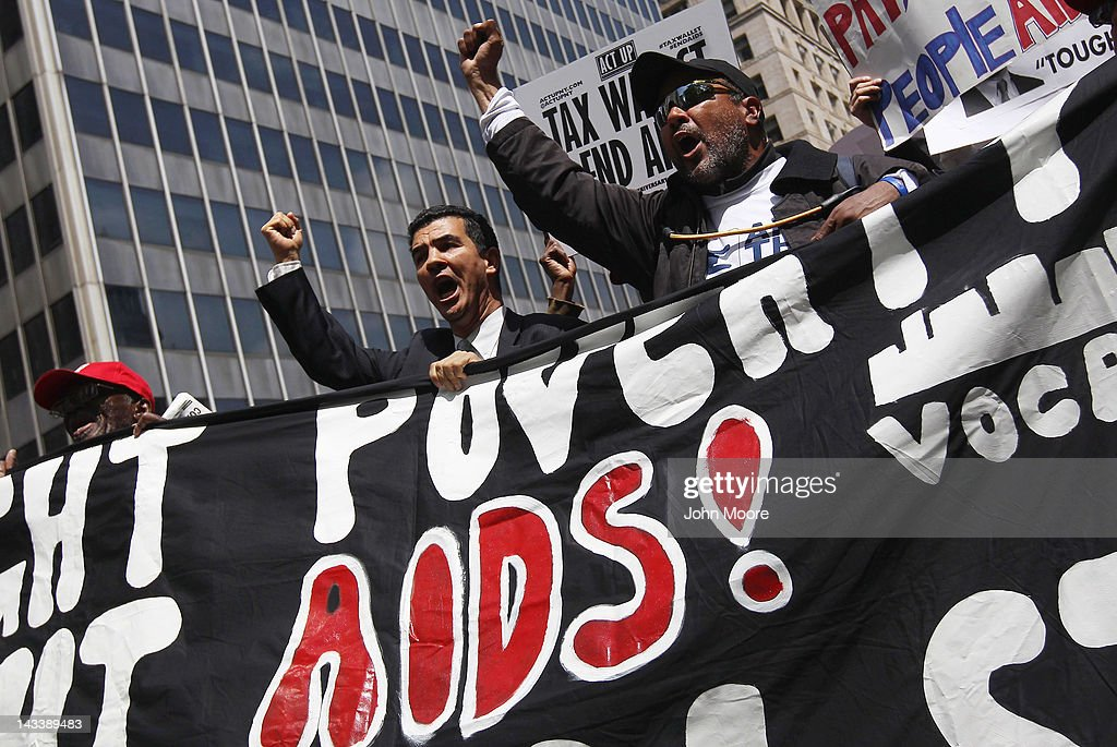 Protesters march to Wall Street during an ACT-UP and Occupy Wall Street demonstration on April 25, 2012 in New York City. ACT-UP (AIDS Coalition to Unleash Power), was marking their 25-year anniversary in supporting services for people with AIDS worldwide. They were joined by Occupy Wall Street protesters in a march from New York's city hall to Wall Street. The groups called for a tax on Wall Street transactions and speculative trades to raise money for to end the global AIDS epidemic and provide universal healthcare in the U.S.