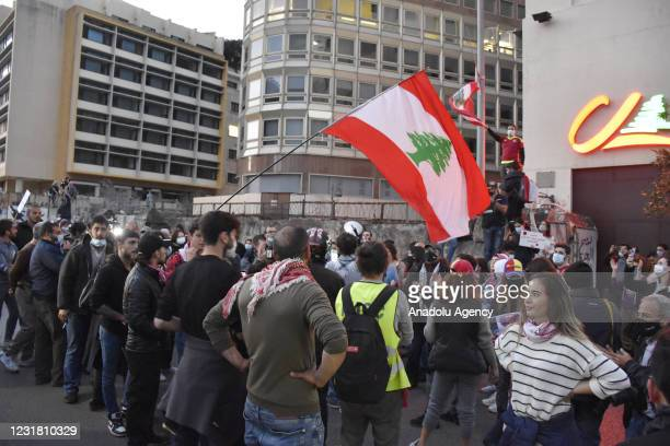 Protesters march towards Energy Ministry building during a protest against record depreciation of the local currency and the current economic crisis...