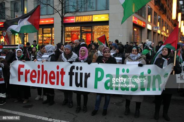 Protesters march towards Pariser Platz from Spandauer street to stage a demonstration against US President Donald Trump's recognition of Jerusalem as...