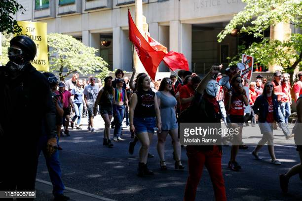 Protesters march towards Pioneer Courthouse Square in preparation to demonstrate against members of HimToo and Proud Boys on June 29 2019 in Portland...