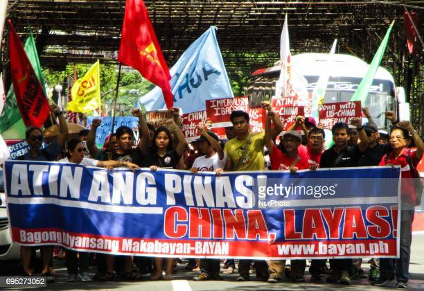 Protesters march towards the Chinese consulate during a rally coinciding the 119th Philippine Independence Day in the financial district of Makati...