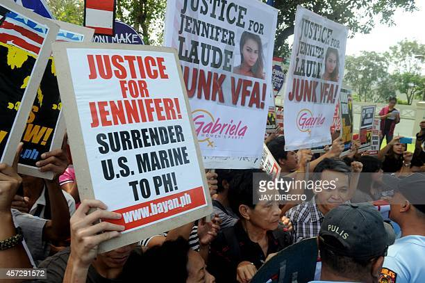 Protesters march towards the gate of the US embassy as they shout antiUS slogans at a rally at the US embassy in Manila on October 16 demanding a US...