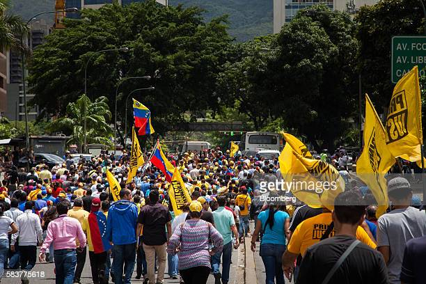 Protesters march towards the national electoral board during a demonstration in support of a referendum on the rule of President Nicolas Maduro not...