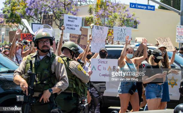 Protesters march with hands up through West Hollywood to demand justice for the killing of George Floyd during march on Wednesday, June 3, 2020 in...