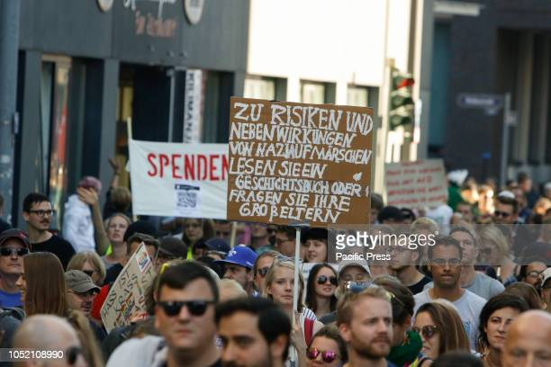 Protesters march with posters through Frankfurt Over 3500 people marched through Frankfurt to protest against racism and for tolerance They were...