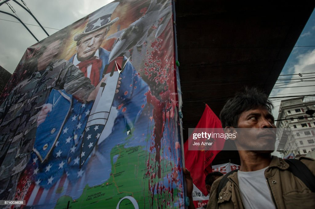 Protesters marched with a mural of Philippines president Duterte and US President Trump on November 14, 2017 in Manila, Philippines. Hundreds of Filipinos protested in Manila as U.S. President Donald Trump attended the Association of Southeast Asian Nations (ASEAN) Summit in the Philippines, marking the last leg of his 12-day Asia trip.