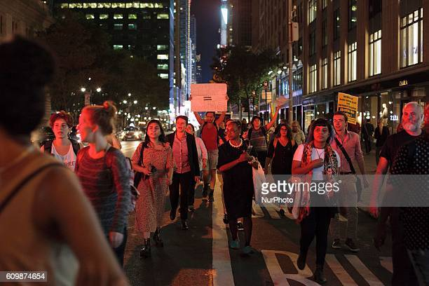 Protesters marching along 42nd street of Manhattan on 21 September 2016 to protest against the killing of Keith L Scott in North Carolina. After...