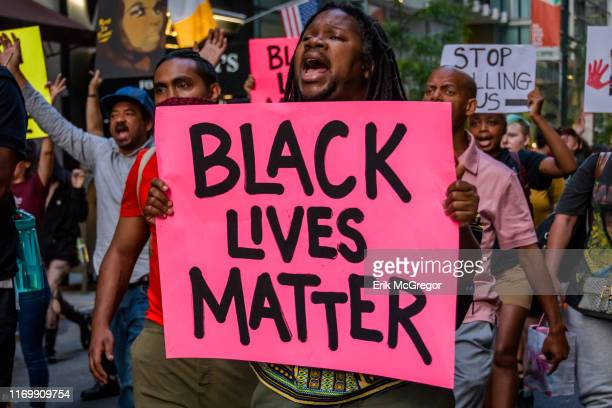 Protesters marching in the streets Community organizations and Activists demanding police accountability gathered for a rally and march at the clock...