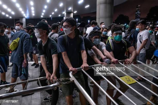 Protesters move a barricade during a clash at Legislative Council after a rally against the extradition law proposal at the Central Government...