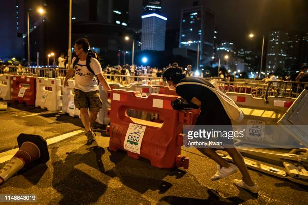 Protesters move a water horse during a clash after a rally against the extradition law proposal at the Central Government Complex on June 10 2019 in...