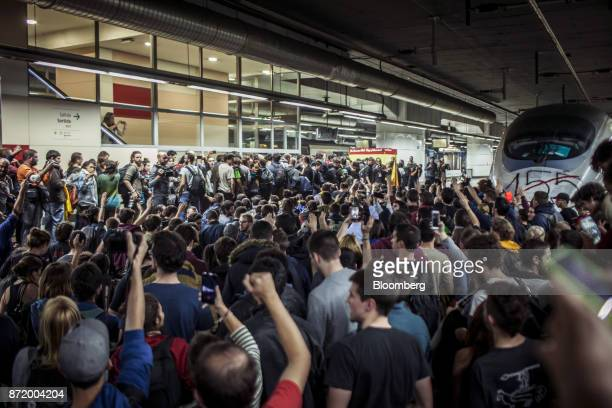 Protesters occupy a platform and block the rail tracks used by Alta Velocidad Espanola highspeed trains operated by Renfe Operadora SC at Barcelona...