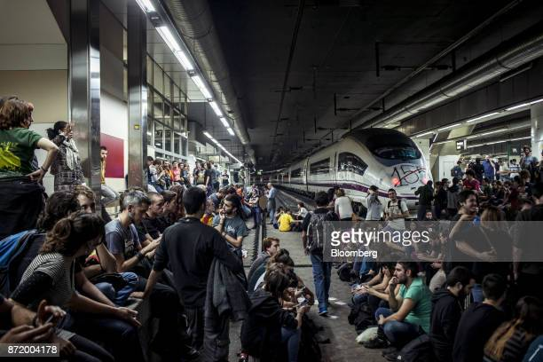Protesters occupy a platform and walk on the rail tracks used by Alta Velocidad Espanola highspeed trains operated by Renfe Operadora SC at Barcelona...