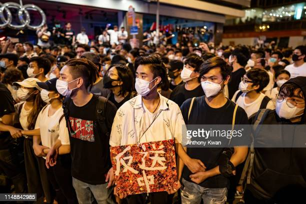 Protesters occupy a street after a rally against the extradition law proposal at the Central Government Complex on June 10 2019 in Hong Kong China...