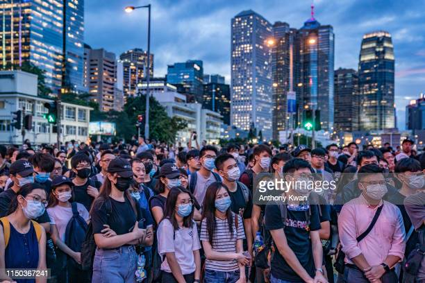 Protesters occupy a street demanding Hong Kong leader to step down after a rally against the nowsuspended extradition bill outside of the Chief...