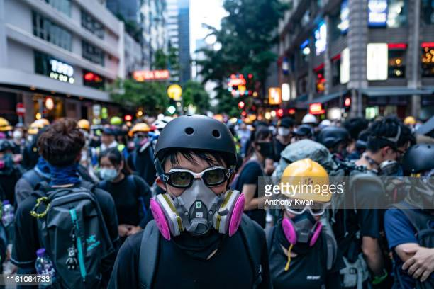 Protesters occupy a street during a standoff with police in Wan Chai district during a demonstration on August 11 2019 in Hong Kong China...