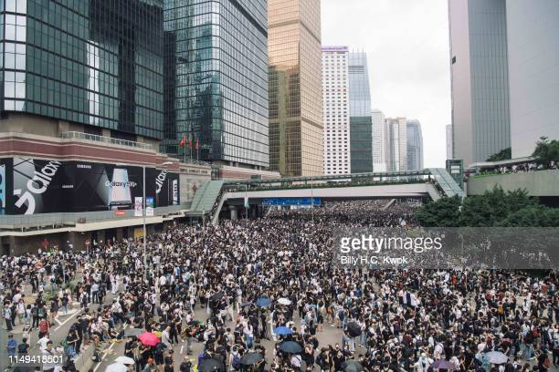 Protesters occupy major roads near Hong Kong's Legislative Council building against a controversial extradition law proposal on June 12 2019 in Hong...