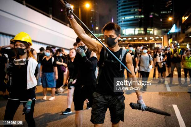 Protesters occupy roads in Sheung Wan during a protest against a proposed extradition bill from Victoria Park in Hong Kong China on July 21 2019...
