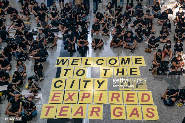 Protesters occupy the arrival hall of the Hong Kong International Airport during a demonstration on August 11 2019 in Hong Kong China Prodemocracy...