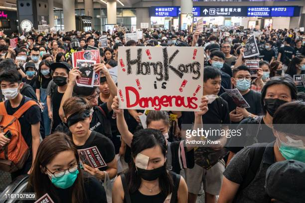 Protesters occupy the arrival hall of the Hong Kong International Airport during a demonstration on August 12 2019 in Hong Kong China Prodemocracy...
