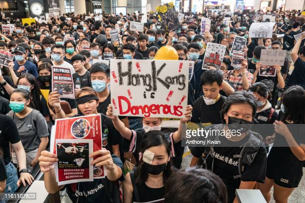 Protesters occupy the arrival hall of the Hong Kong International Airport during a demonstration on August 12, 2019 in Hong Kong, China....