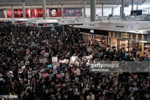 Protesters occupy the departure hall of the Hong Kong International Airport during a demonstration on August 12 2019 in Hong Kong China Prodemocracy...