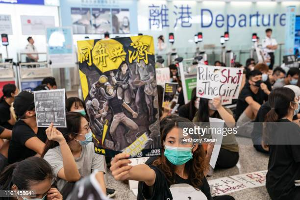 Protesters occupy the departure hall of the Hong Kong International Airport during a demonstration on August 13 2019 in Hong Kong China Prodemocracy...
